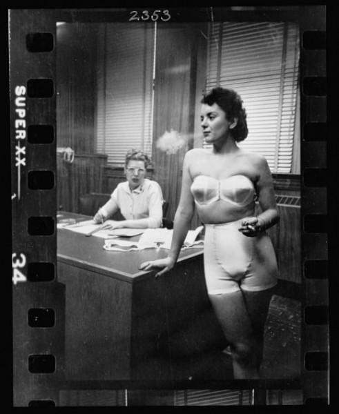 04-22.-Woman-model-standing-in-an-office-smoking-while-modeling-undergarments-520x635-491x600