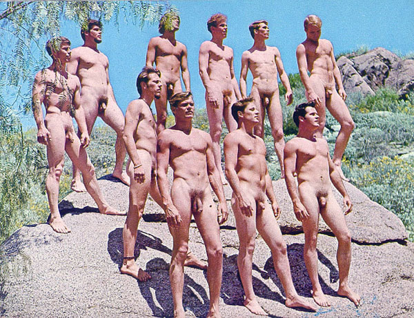 A-bunch-of-naked-men-standin-on-a-rock-in-the-1960s