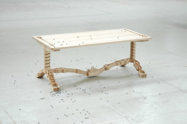 A Table with Built-In Tracks for Marbles: marble