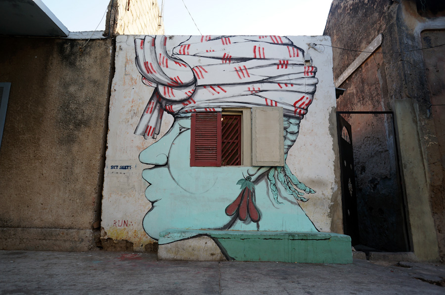Murals in Senegal and Gambia by RUN: run_dak_wom_w_1000.jpg