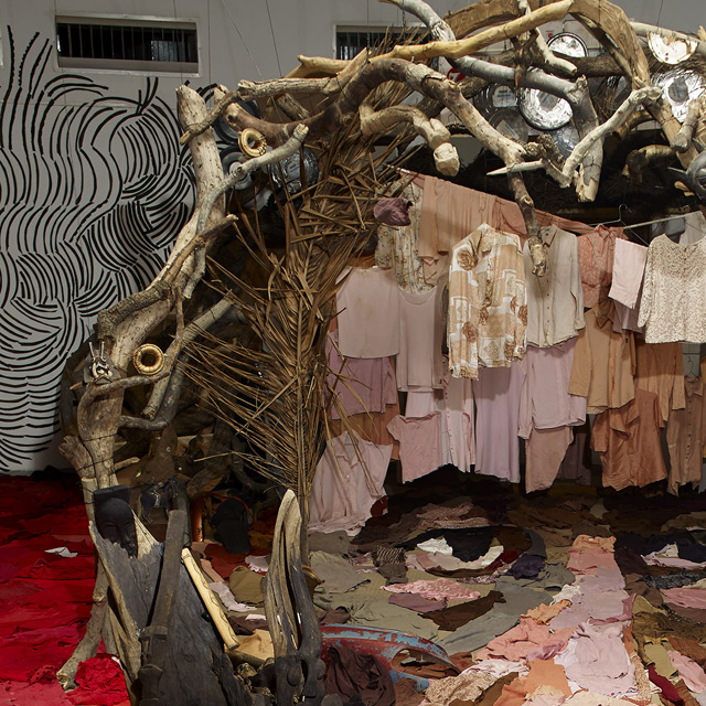 Incredible Anamorphic Portrait Composed of an Entire Room of Objects: pras-2.jpg