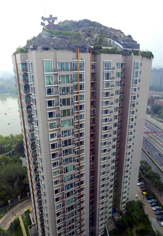 Man Builds Mountain Villa on Beijing Apartment Building: mountain-1.jpg