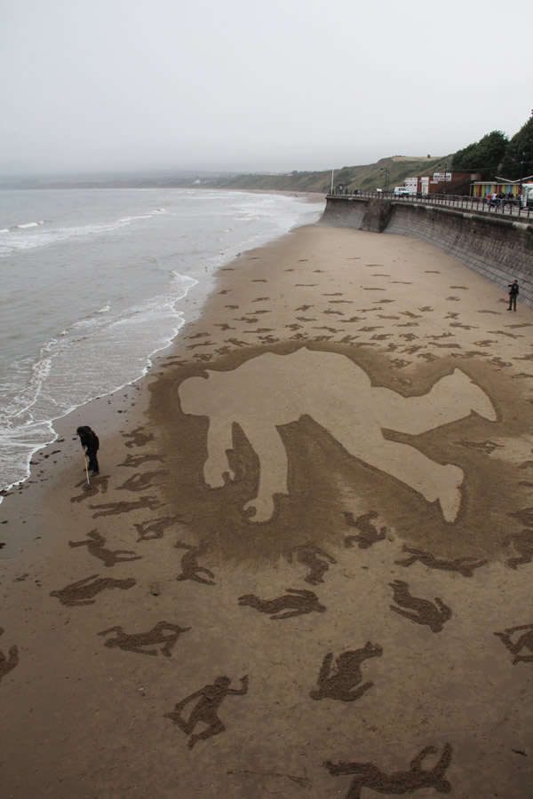 9,000 Stenciled Sand Silhouettes on Normandy Beach: andy_moss.jpg