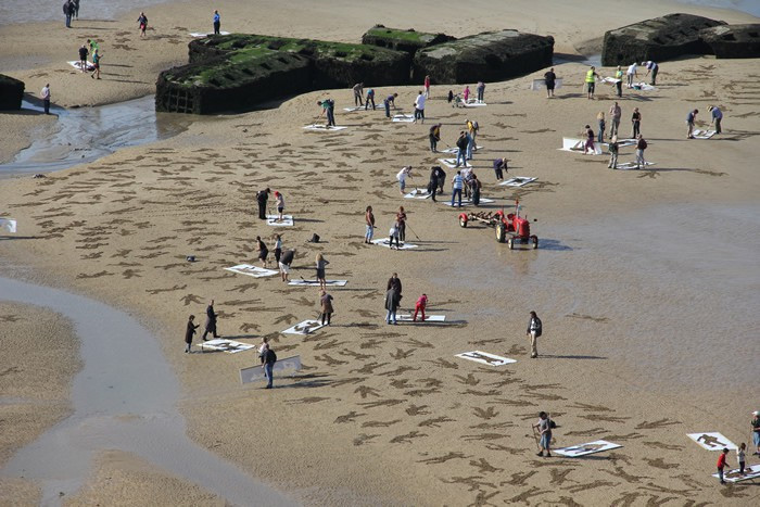 9,000 Stenciled Sand Silhouettes on Normandy Beach: sand-10.jpeg