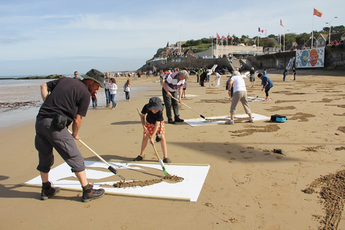 9,000 Stenciled Sand Silhouettes on Normandy Beach: sand-4.jpeg