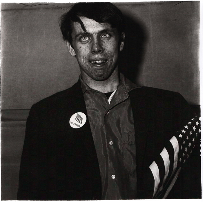 The Strange Characters of Diane Arbus: 01_Arbus,-patriotic-young-man-with-a-flag,-nyc,-1967.jpg