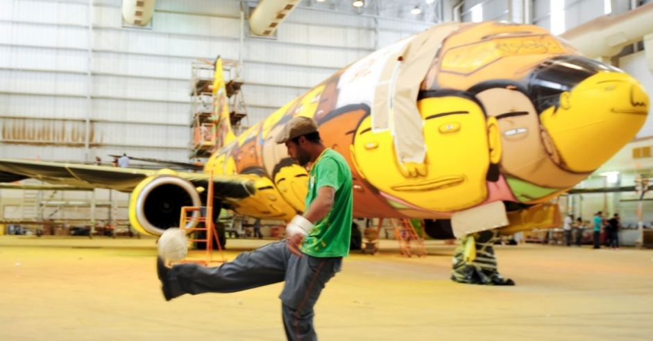 Os Gemeos Paints the Brazilian National Team's Plane: Screen Shot 2014-05-26 at 10.01.23 AM.png