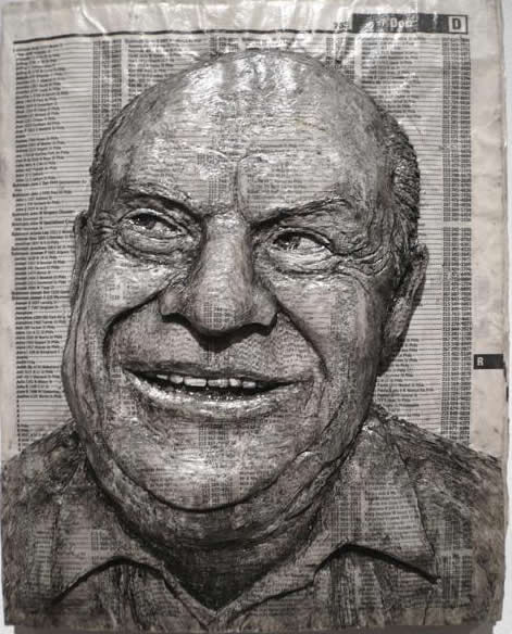Alex Queral Carves Faces Into Phonebooks: phone-book-sculptures10.jpg