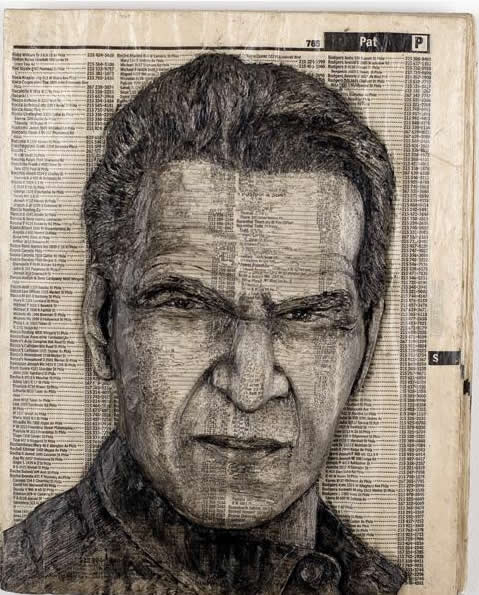Alex Queral Carves Faces Into Phonebooks: phone-book-sculptures11.jpg
