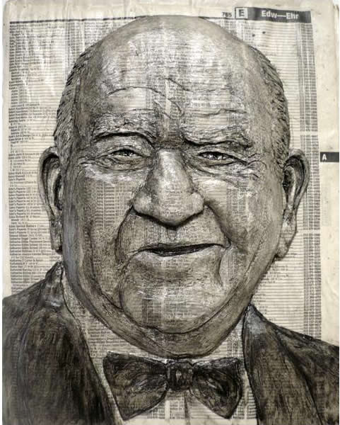 Alex Queral Carves Faces Into Phonebooks: phone-book-sculptures12.jpg