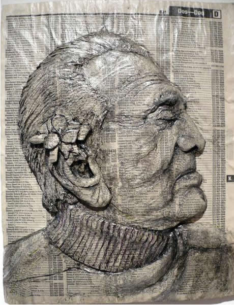 Alex Queral Carves Faces Into Phonebooks: phone-book-sculptures13.jpg