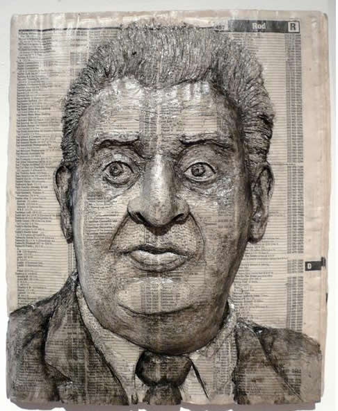 Alex Queral Carves Faces Into Phonebooks: phone-book-sculptures14.jpg