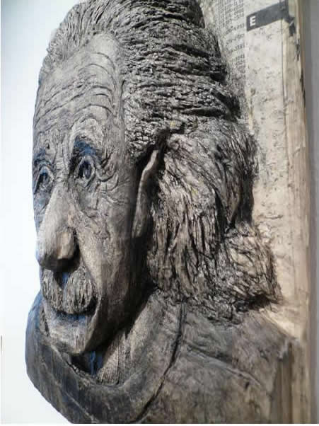 Alex Queral Carves Faces Into Phonebooks: phone-book-sculptures2.jpg