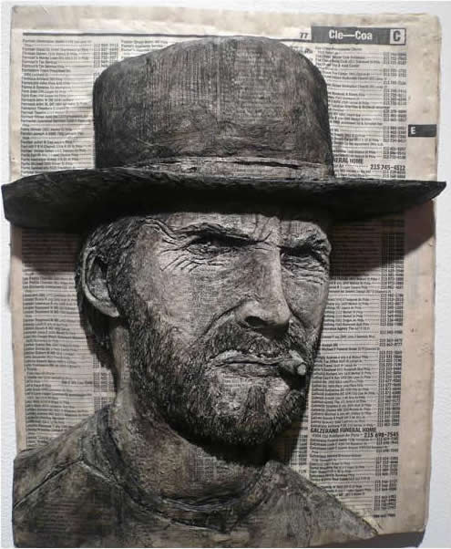 Alex Queral Carves Faces Into Phonebooks: phone-book-sculptures3.jpg