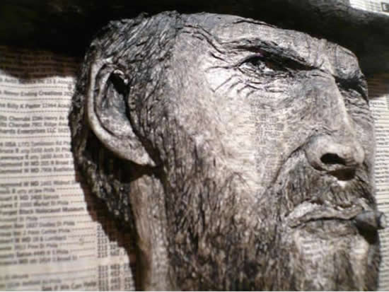Alex Queral Carves Faces Into Phonebooks: phone-book-sculptures4.jpg