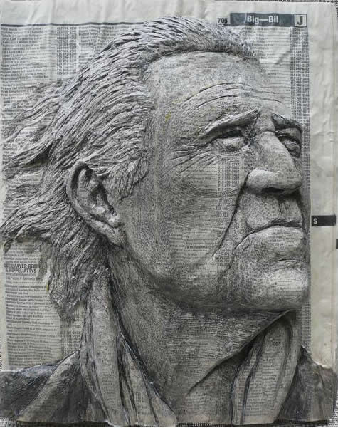 Alex Queral Carves Faces Into Phonebooks: phone-book-sculptures9.jpg