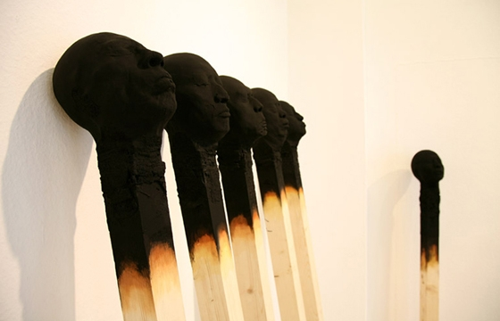 Giant Charred Matchstick Faces by Wolfgang Stiller