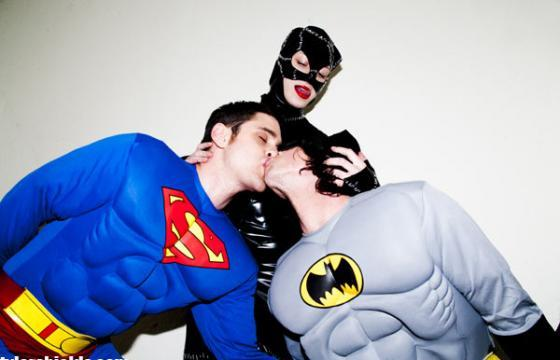 Superman, Batman and Catwoman in BED