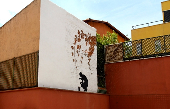 Painting branches mural by Pejac