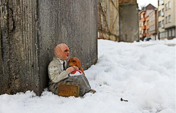 Miniature Homeless man by Isaac Cordal