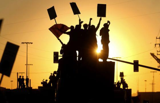 Occupy the Port: General Strike Halts Shipping, Police Strike Back