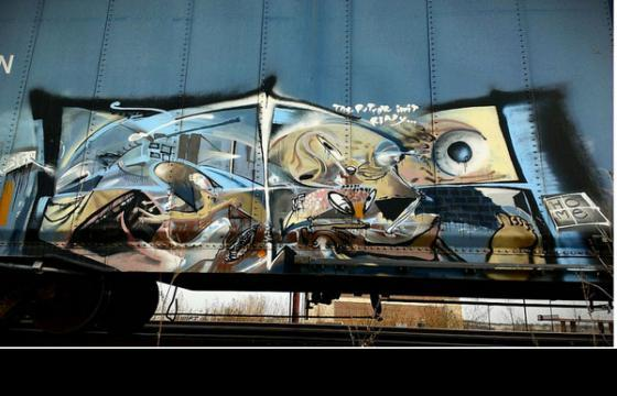 Surreal piece by Home on a boxcar