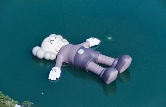 KAWS Now Has a Massive Floating Sculpture in Seoul's Seokchon Lake