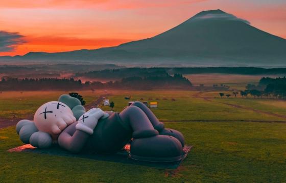 """KAWS Takes a """"HOLIDAY"""" at the Foot of Mt. Fuji"""